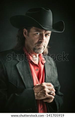 Portrait of a stern looking cowboy.