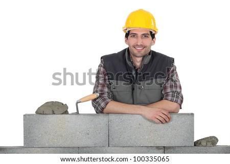 Portrait of a stonemason at work - stock photo