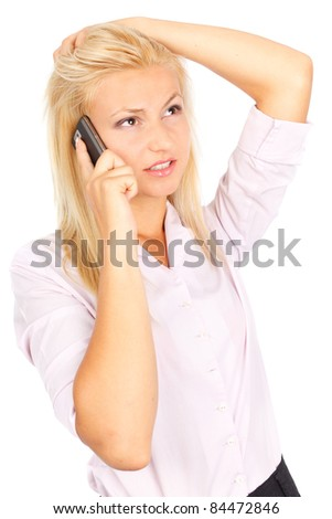 Portrait of a stressed businesswoman speaking on cellphone isolated on white