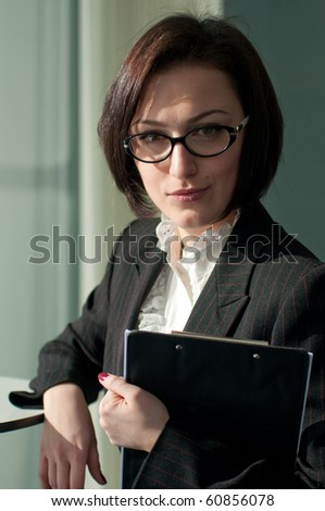 Portrait of a strict businesswoman with glasses - stock photo