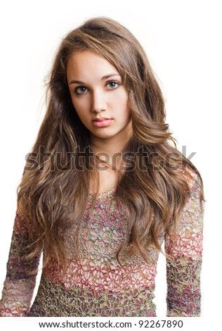 Portrait of a striking beautiful young brunette girl with emotional facial expression. - stock photo