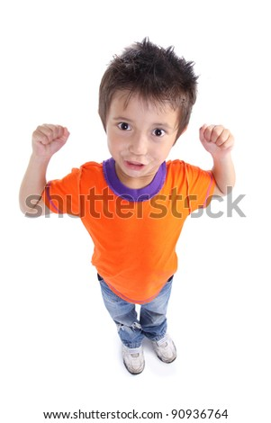 portrait of a strong happy little boy standing on white background
