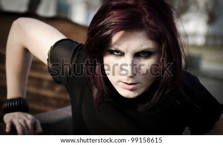Portrait of a strong woman near an outdoor dumpster - stock photo