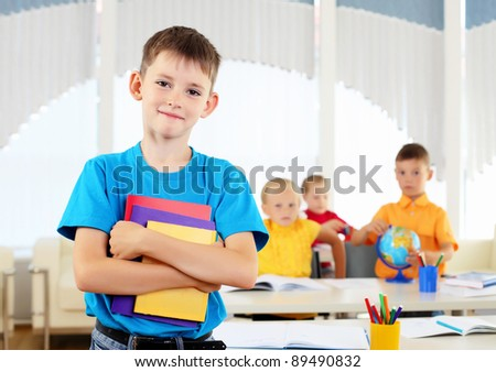 Portrait of a student is in class - stock photo