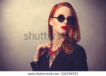 Portrait of a style redhead women - stock photo