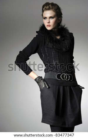 Portrait of a styled professional model on gray background - stock photo