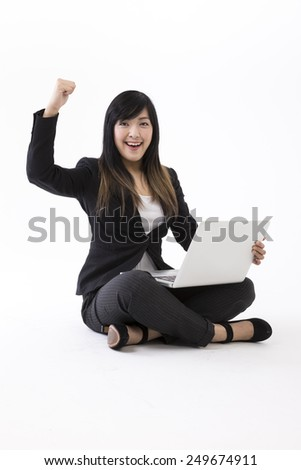 Portrait of a stylish Asian Businesswoman using a laptop. Isolated on white background. Chinese brunette female model.