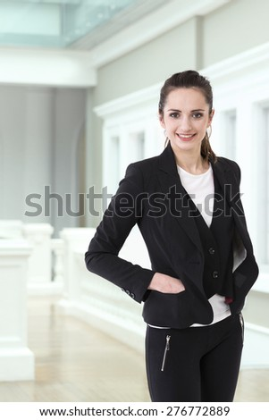 Portrait of a stylish Businesswoman. Caucasian brunette female model. - stock photo