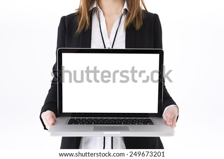Portrait of a stylish Businesswoman using a laptop. Isolated on white background. Caucasian brunette female model. - stock photo