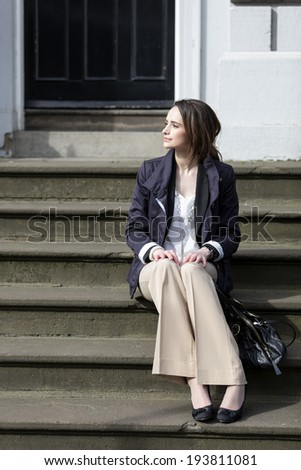 Portrait of a stylish caucasian woman in the city. business or lifestyle image. - stock photo