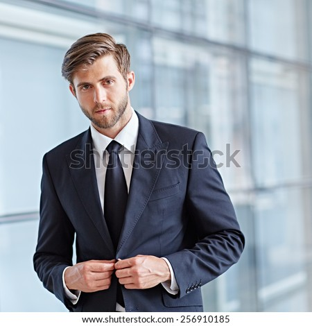 Portrait of a stylish corporate executive looking seriously at the camera - stock photo