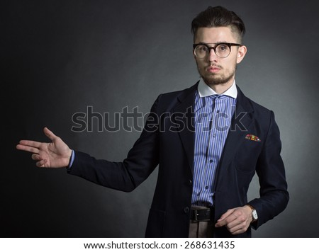 Portrait of a stylish male hipster in  jacket. - stock photo