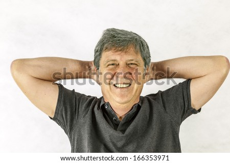 Portrait of a stylish  man standing and gesturing with his hands - stock photo