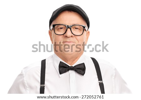 Portrait of a stylish senior with a beret and a bow-tie, smiling and looking at the camera isolated on white background - stock photo