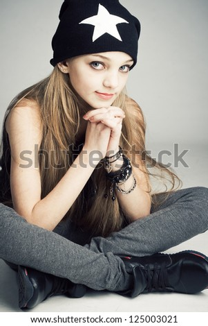 Portrait of a stylish teenage girl - stock photo