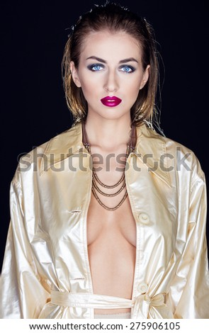 Portrait of a stylish woman in a raincoat - stock photo