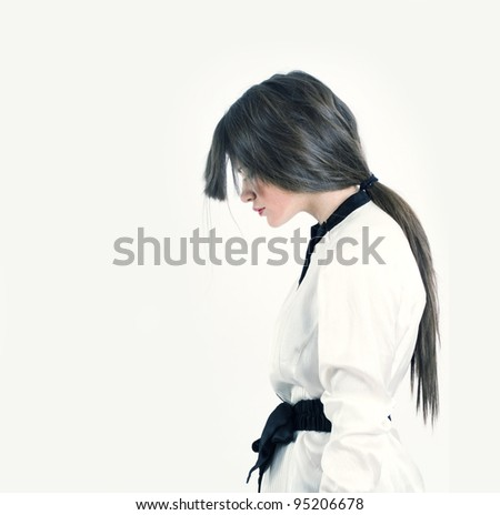 Portrait of a stylish woman on a white background. - stock photo