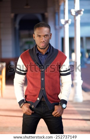 Portrait of a stylish young african american man posing outdoors - stock photo