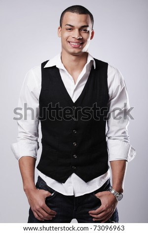 Portrait of a stylish young fashion male model.