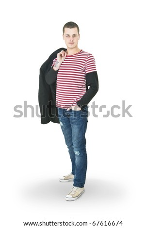 Portrait of a stylish young man with tattoos on his arm - stock photo