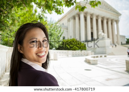 Portrait of a successful Asian American woman in Washington DC at the Supreme Court building - stock photo