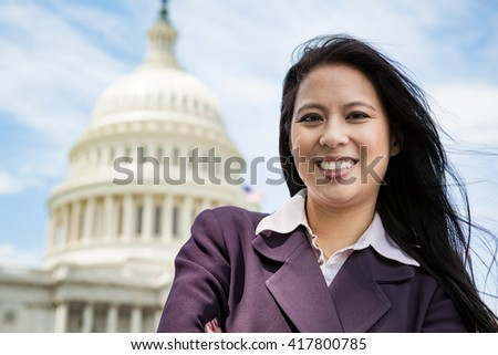 Portrait of a successful Asian American woman in Washington DC on Capitol Hill - stock photo