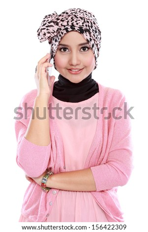 Portrait of a successful asian muslim woman calling by phone and looking at camera - stock photo
