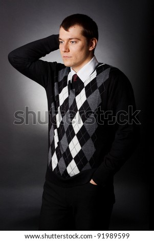 Portrait of a successful business man in a suit. black background - stock photo