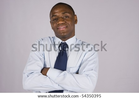 Portrait of a successful business man isolated on a gray background - stock photo
