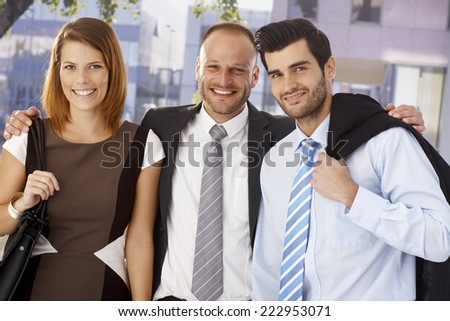 Portrait of a successful business team posing outdoors, looking at camera. - stock photo