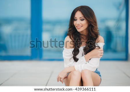 Portrait of a successful business woman smiling. Beautiful young female executive in an urban setting. Beautiful woman smiling. Pretty Happy Woman
