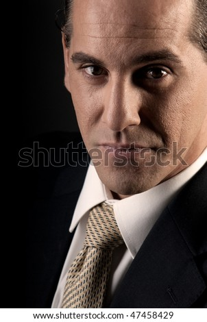 Portrait of a successful businessman looking to camera. - stock photo