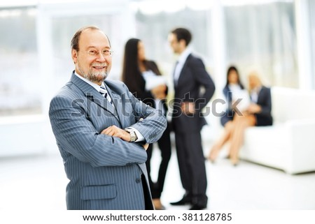portrait of a successful businessman on background of office - stock photo