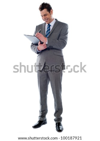 Portrait of a successful businessman writing notes on clipboard isolated on white background - stock photo