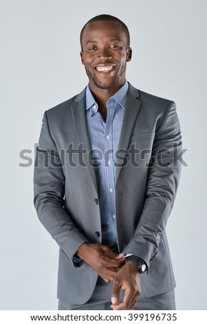 Portrait of a successful confident african businessman professional in a smart formal suit - stock photo