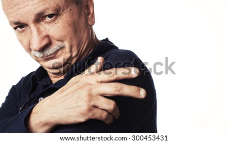 Portrait of a successful elderly man isolated on white background with copy-space.  High-contrast image with intentional color shift - stock photo