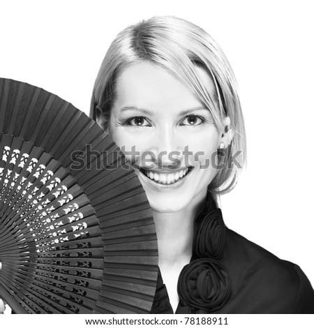 Portrait of a successful,  elegant, atractive, business woman wearing black blouse holding folding fan. - stock photo