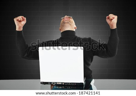 Portrait of a successful man with hand raised in air - with blank space - stock photo