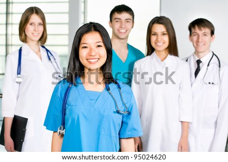 Portrait of a successful medical team at work in hospital - stock photo