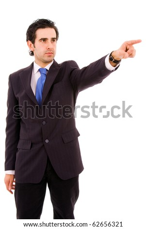 Portrait of a successful young business man pointing at something interesting at the office, isolated on white