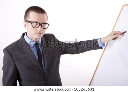 Portrait of a successful young business man pointing forward on whiteboard.