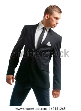 Portrait of a successful young business man standing isolated on white background - stock photo