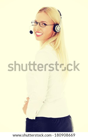 Portrait of a successful young female call centre employee wearing a headset - stock photo