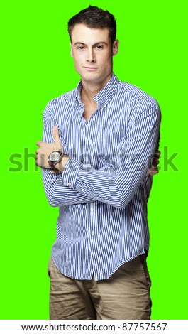 portrait of a successful young man over a removable chroma key background - stock photo