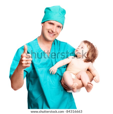 portrait of a surgeon holding a  baby and his thumb up, isolated against white background - stock photo