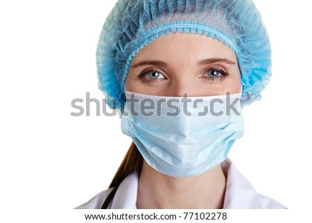 Portrait of a surgical nurse with mouth guard and hairnet - stock photo