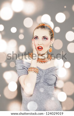 portrait of a surprise and sexy pin-up girl. Bokeh light background. - stock photo