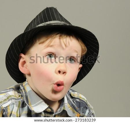 Portrait of a surprised boy - stock photo