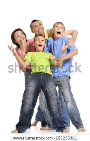 Portrait of a surprised family of four people on a white background - stock photo