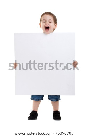 Portrait of a surprised little boy holding a billboard against white background - stock photo